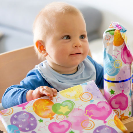 Little Toddler Baby Boy Opening Presents For Birthday