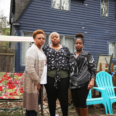 Monique, Ashley Gunn and Alicia stand outside Ashley's house