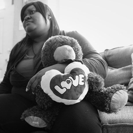 Jessica Byas-Lurgio holds a stuffed animal that belonged to her half-sister, Nicole.