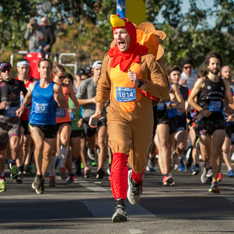 Chris Conlan leads the runners at the start of the 27th annual ThunderCloud Subs Turkey Trot in downtown Austin, Texas, on Nov. 23, 2017.