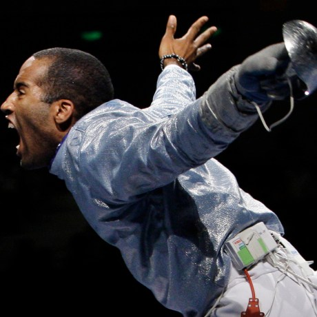 Keeth Smart celebrates after defeating Russia 45-44 in the semifinals of the men's team saber in fencing during the Beijing 2008 Olympics.