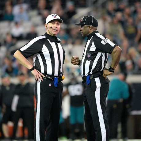 Referee Brad Allen, left, and umpire Barry Anderson (20) talk on the field during the second half of an NFL football game against the Indianapolis Colts on Dec. 29, 2019, in Jacksonville, Fla. Umpire Anderson will be part of the Super Bowl officiating bcrew.