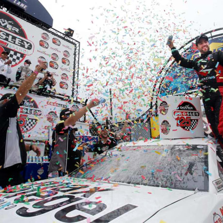 Image: Program alumni, Ruben Garcia Jr., celebrates with No. 6 Max Siegel Inc. Toyota car in the victory lane at Dover International Speedway.