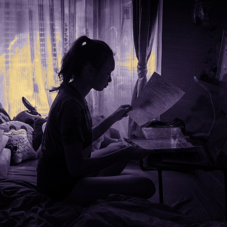 Image: Chloe Lau, a high school student in Hong Kong, does her schoolwork at home on March 4, 2020.
