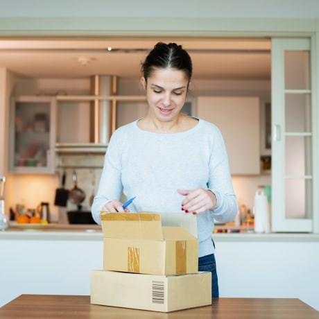 Woman receiving delivery at home