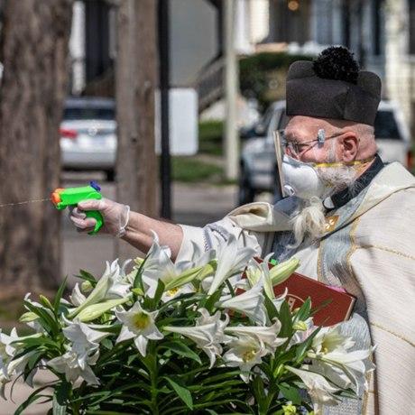 priest uses squirt gun