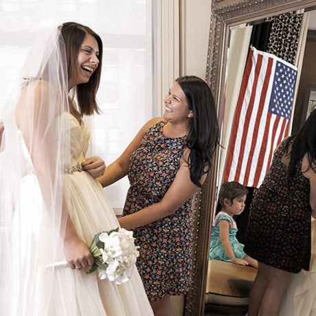 """A bride says \""""yes\"""" to the dress at a Brides Across America event in Chicago in 2018."""