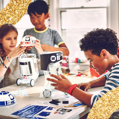 8 year old children playing with star wars droid kit