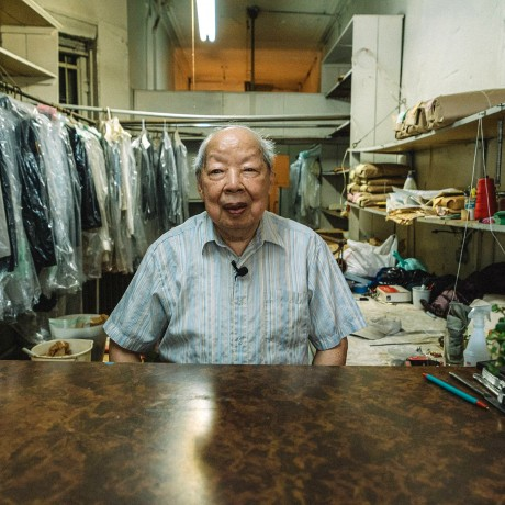Robert Lee inside Sun's Laundry, his business of 61 years on the Lower East Side of New York City.