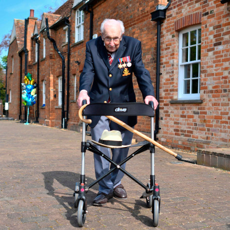 Image: British World War II veteran Captain Tom Moore, 99, poses with his walking frame doing a lap of his garden in the village of Marston Moretaine