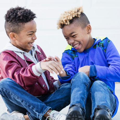 Two nine year old boys playing outside