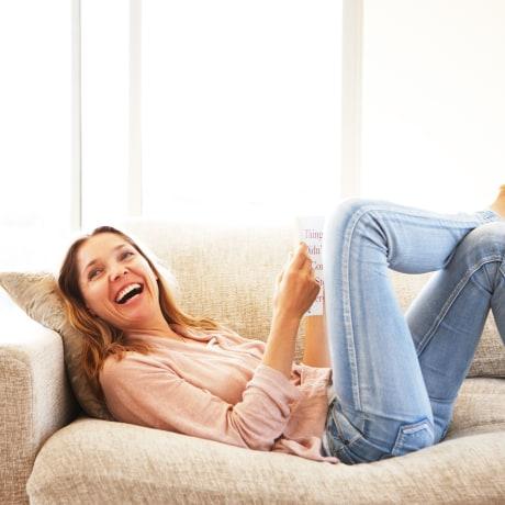 Woman on sofa smiling