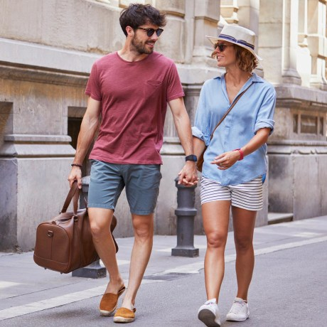 Boyfriend and Girlfriend strolling outside wearing summer clothes