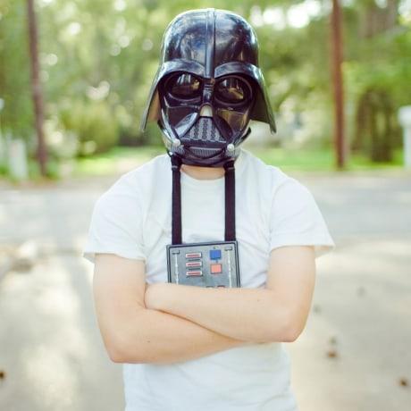 Kid wearing a Darth Vader Mask outside