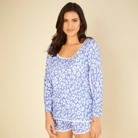Image of a woman wearing a Cosabella sleep set in blue
