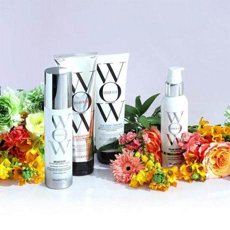 Color Wow hair products surrounded by florals