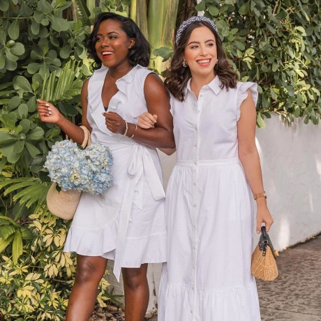 Two Woman walking wearing Draper James white dresses