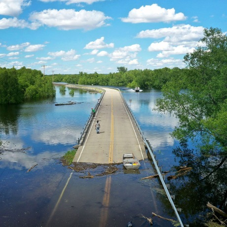 Floodwater from the Mississippi River cuts off the roadway from Missouri into Illinois at the states' border on May 30, 2019