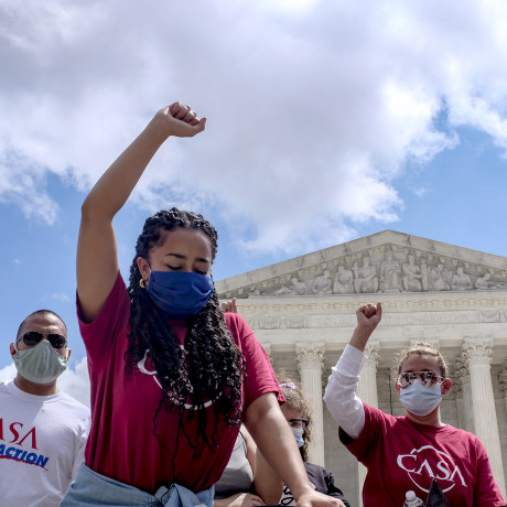 Image: Demonstrators raise their fists in protest outside of the Supreme Court in Washington in 2020.