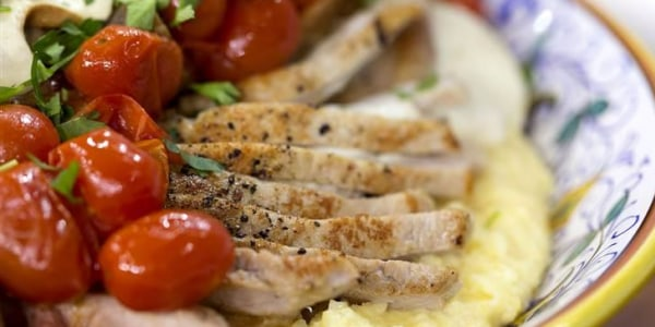 Mozzarella-Stuffed Pork Chops with Polenta and Tomatoes