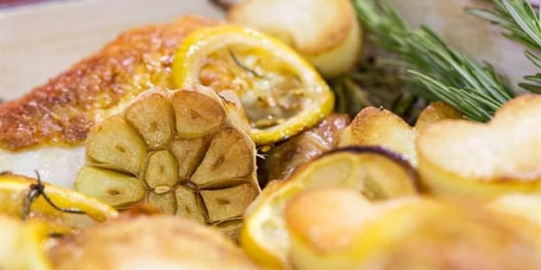 Lemon rosemary baked chicken with heart-shaped roasted potatoes