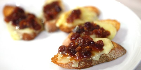 Phyllo-Wrapped Baked Brie with Spiced Boozy Cranberry Relish & Crostinis