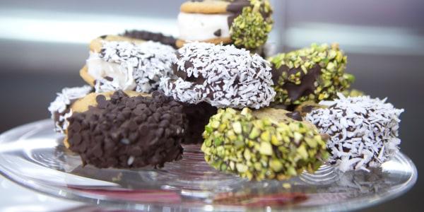 Vegan ice cream sandwiches dipped in chocolate