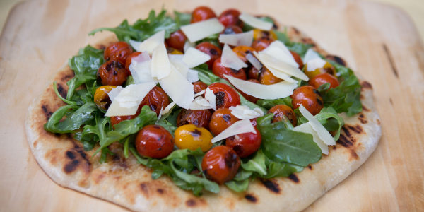 Grilled Flatbread with Arugula Salad and Blistered Tomatoes