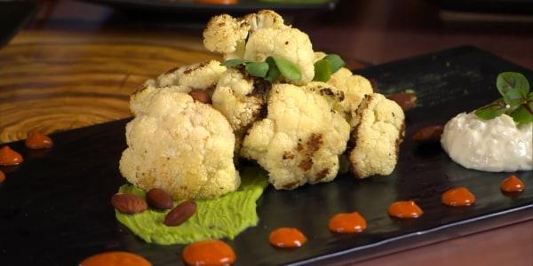 Roasted Cauliflower with Pea Pesto and Feta Cream