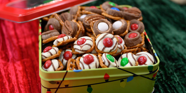 Chocolate Pretzel Hugs with Red and Green Holiday Candies