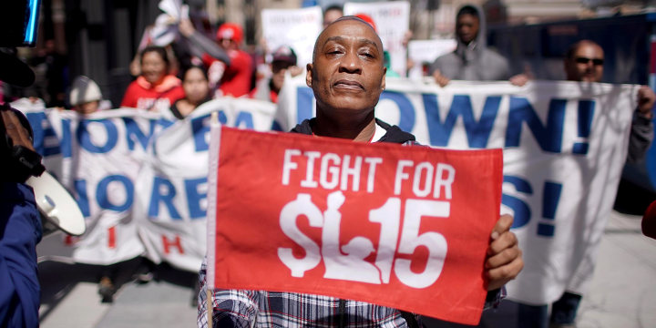 Demonstrators march in front of the McDonalds Headquarters demanding a minimum wage of $15-per-hour and union representation on April 3, 2019 in Chicago.