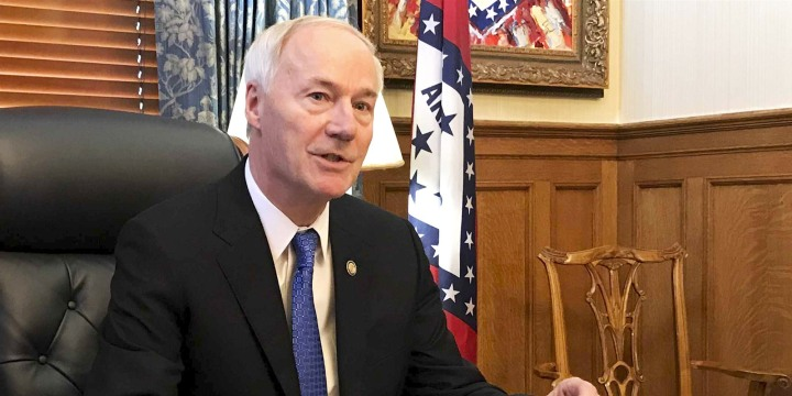 Image: Arkansas Gov. Asa Hutchinson speaks in his office in Little Rock on April 10, 2019