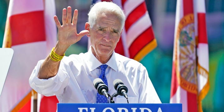 Rep. Charlie Crist, D-St. Petersburg, waves to supporters during a campaign rally as he announces his run for Florida governor on May 4, 2021, in St. Petersburg, Fla.