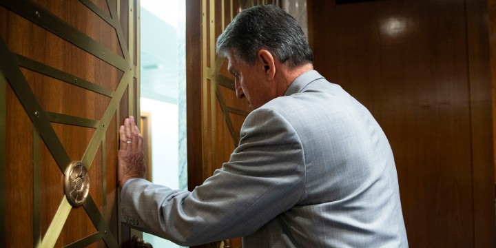 Sen. Joe Manchin, D-W.Va., departs a Senate Appropriations Subcommittee hearing on June 9, 2021.
