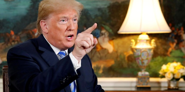 Trump brands new Iran sanctions as 'the most biting ever imposed'