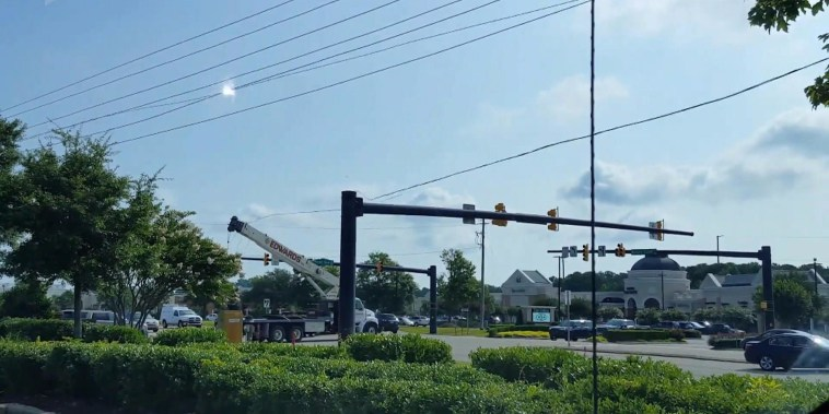 Truck driver has a rough day when crane collides with power line