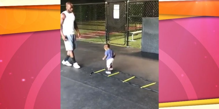Watch this adorable toddler hit the gym with his dad