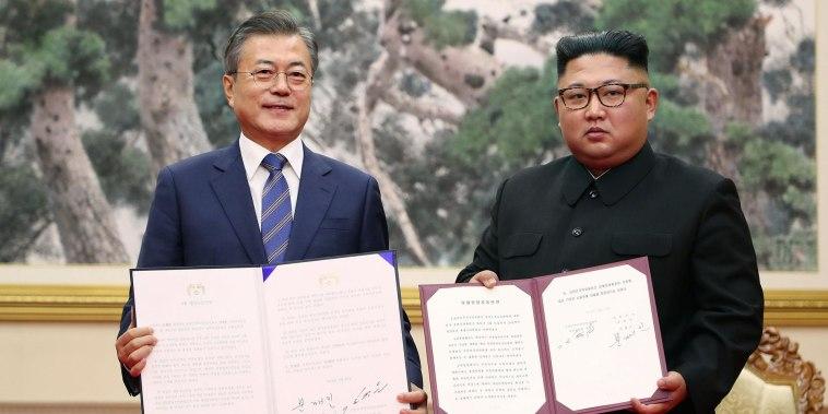 Leaders of North and South Korea pledge to create a nuclear-free peninsula