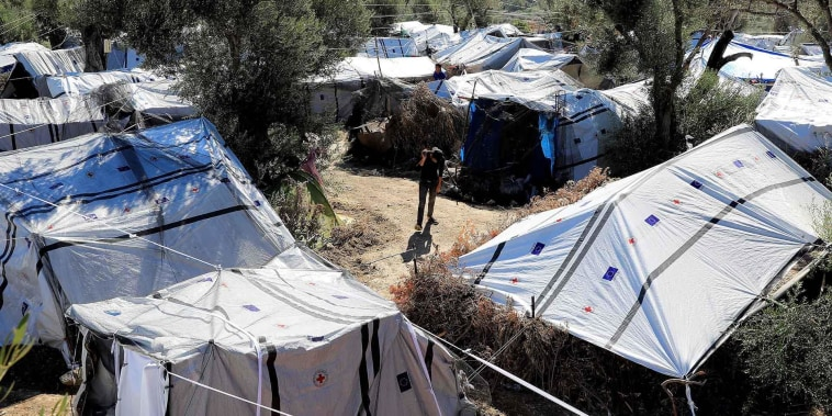 Thousands moved from 'inhumane' camp as Greece rethinks asylum-seeker policy