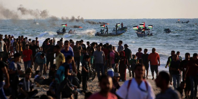 Palestinians protest Gaza blockade on land and sea