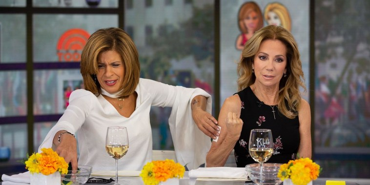 Kathie Lee and Hoda (temporary) tattoo each other