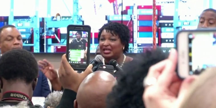 Stacey Abrams slams Brian Kemp for 'abusing powers' in Georgia