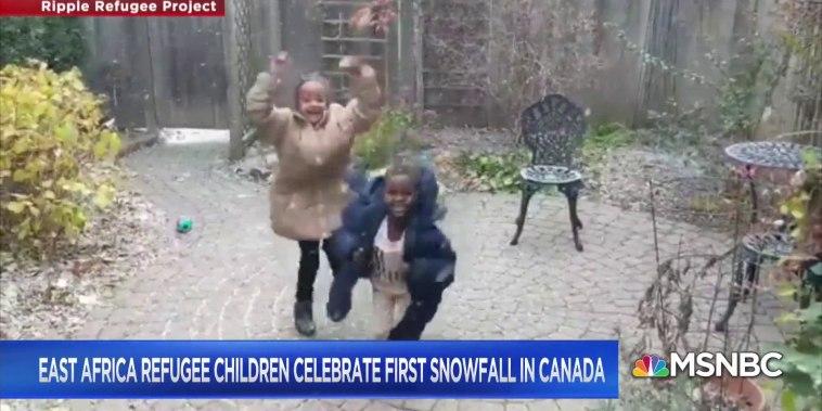 Refugee children celebrate first snowfall in Canada