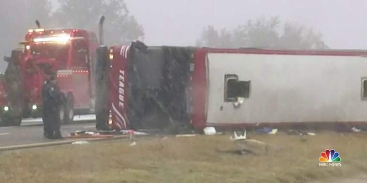 Two killed when tour bus overturns along icy highway in winter blast