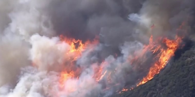 Strong winds fuel destructive Southern California wildfire