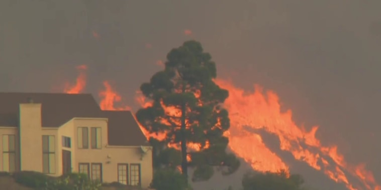 California community threatened by wildfire after mass shooting