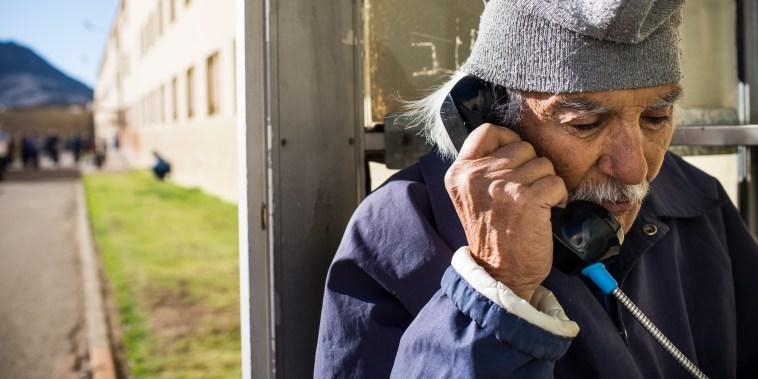 Anthony Alvarez, age 82, talks on the phone to his 80-year-old sister at California Men's Colony prison in San Luis Obispo, Dec. 20, 2013.