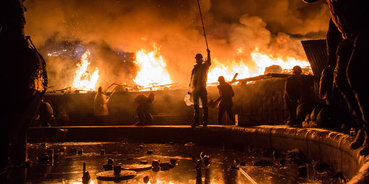 Anti-government protesters guard the perimeter of Independence Square, known as Maidan, on Feb. 19, 2014, in Kiev, Ukraine.