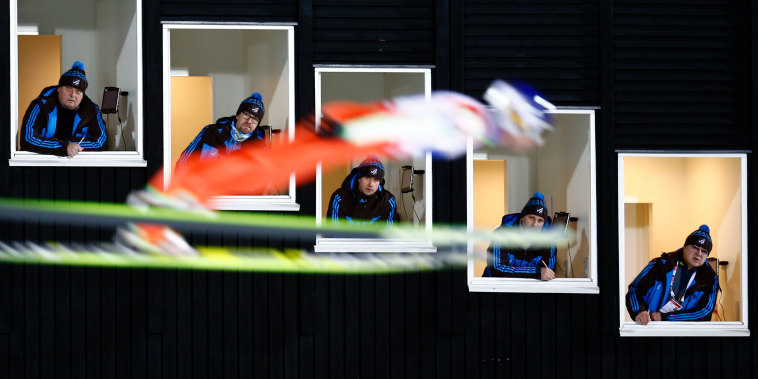 Finland's Ahonen soars past judges windows during the normal hill HS100 mixed team ski jumping event of the Nordic World Ski Championships in Falun