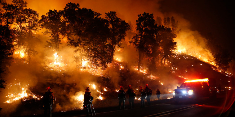 Firefighters with the Marin County Fire Department's Tamalpais Fire Crew monitor a backfire as they battle the Valley Fire on Sep. 13, 2015 near Middletown, Calif. (Photo by Stephen Lam/Getty)